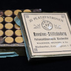 $300 - This is a German tin made by Walbinger, Meuschel & Co. out of Bischweiler. It is full of 25 blank cartridges.